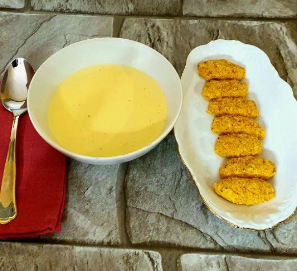 Crema reina de ave y quenelles de parmesano
